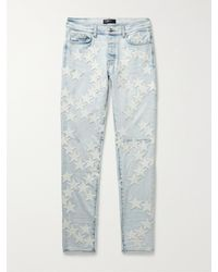 Amiri Chemist Skinny-fit Leather-appliquéd Stretch-denim Jeans - Blue