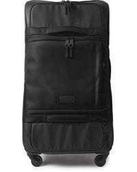 Eastpak Ridell L Cnnct 75cm Coated-canvas Suitcase - Black