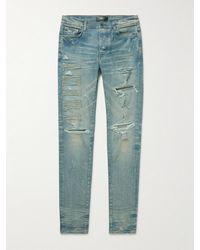 Amiri Skinny-fit Logo-appliquéd Distressed Jeans - Blue
