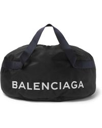 Balenciaga - Logo-embroidered Nylon Holdall - Lyst