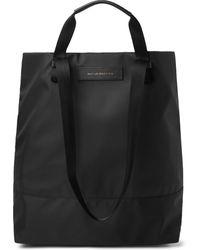 Want Les Essentiels De La Vie Dayton Leather-trimmed Nylon Tote Bag - Black