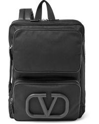 Valentino Garavani Garavani Logo-appliquéd Leather-trimmed Canvas Backpack - Black