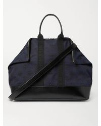 Alexander McQueen Leather-panelled Logo-jacquard Canvas Holdall - Blue