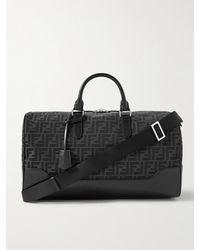 Fendi Leather-trimmed Monogrammed Canvas Duffle Bag - Black