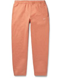 Nike Nrg Tapered Logo-embroidered Fleece-back Cotton-blend Jersey Joggers - Orange