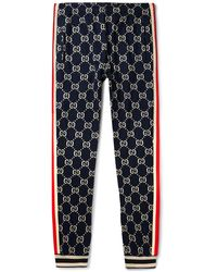 Gucci Tapered Striped Logo-intarsia Cotton Track Pants - Blue