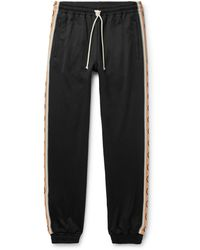 Gucci Slim-fit Logo-jacquard Webbing-trimmed Tech-jersey Track Pants - Black