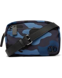Valentino Garavani Leather-trimmed Camouflage-print Canvas Camera Bag - Blue