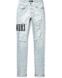 Amiri Skinny-fit Logo-embroidered Distressed Stretch-denim Jeans - Blue