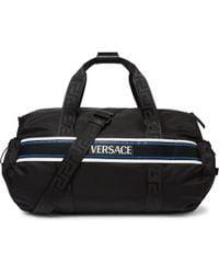 Versace Logo-detailed Webbing-trimmed Nylon Duffle Bag - Black