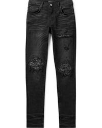 Amiri Mx1 Skinny-fit Panelled Distressed Stretch-denim Jeans - Black