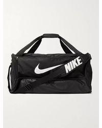 Nike Brasilia Medium Logo-print Canvas And Coated-shell Duffle Bag - Black