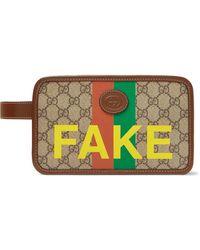 Gucci Logo-appliquéd Leather-trimmed Printed Monogrammed Coated-canvas Wash Bag - Brown