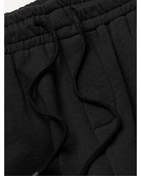 Haydenshapes Arsham Stampd Eroded Appliquéd Embroidered Cotton-jersey Joggers - Black