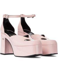 Gucci Plateau-Pumps aus Lackleder - Pink