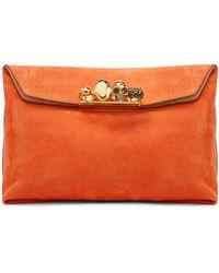 Alexander McQueen Clutch Four Ring aus Veloursleder - Orange