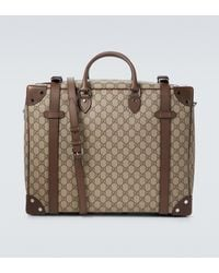 Gucci Leather-trimmed Monogrammed Coated-canvas Suitcase - Brown