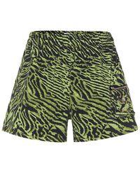 Ganni Shorts di jeans a stampa tigrata - Verde