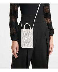 Alaïa Pochette pour téléphone Garance en cuir - Blanc