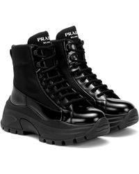 Prada High-Top-Sneakers aus Lackleder - Schwarz