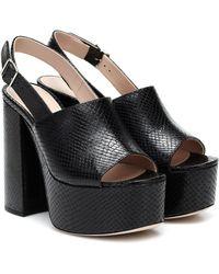 Miu Miu Sandalias de piel con plataforma - Negro