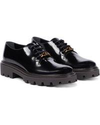 Tod's Chaussures à plateforme en cuir - Noir