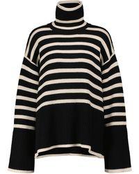 Totême Pull à col roulé en laine et coton à rayures - Noir