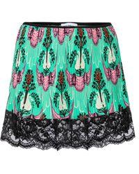 Paco Rabanne Shorts florales de tiro alto - Verde