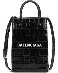 Balenciaga Sac à bandoulière Shopping en cuir embossé - Noir