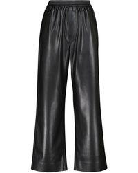 Nanushka Pantalon ample Odessa en cuir synthétique - Noir