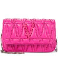 Versace Virtus Small Embellished Leather Crossbody Bag - Pink