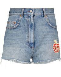 Gucci Short Les Pommes en jean à taille haute - Bleu