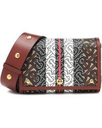Burberry Kleine Crossbody-Tasche aus Eco-Canvas mit Monogrammmuster im Streifendesign - Braun