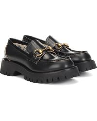 Gucci Flaneurs en cuir noirs Lug Sole
