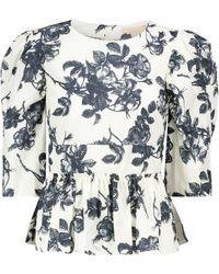 Brock Collection Top Sveva de algodón floral con peplum - Azul