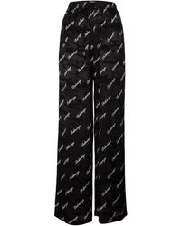 Balenciaga Pantalones anchos de seda con logo - Negro