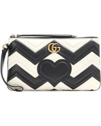 5a4969642 Gucci Gg Marmont Pouch Matelassé Leather Clutch in Black - Lyst