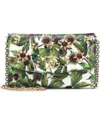 Dolce & Gabbana Clutch de piel estampado - Verde