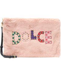 Dolce & Gabbana Verzierte Clutch mit Faux Fur - Pink