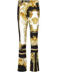 Versace Flared Jeans mit Barocco-Print - Mettallic