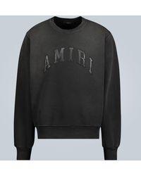 Amiri Sweat-shirt à logo en cuir embossé - Noir