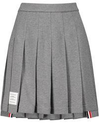 Thom Browne Minifalda de piqué de algodón plisada - Gris