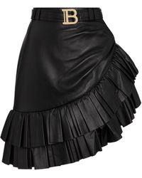 Balmain Minifalda de piel con volantes - Negro