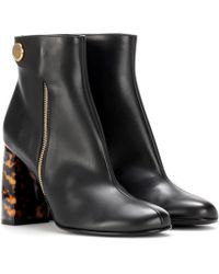 752c9c63f86 Stella McCartney Embellished Patent Ankle Boots in Black - Lyst