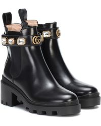 Gucci Verzierte Ankle Boots aus Leder - Schwarz