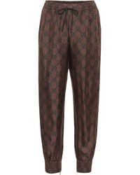 Gucci Pantalon de survêtement GG Supreme en soie - Marron
