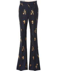 Gucci - Pantaloni flared in cotone e lana - Lyst