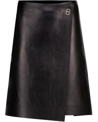 Bottega Veneta Mini-jupe portefeuille en cuir - Noir