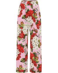 Dolce & Gabbana - Pantalon imprimé en satin de soie mélangée - Lyst