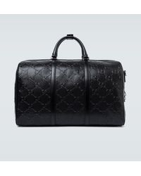 Gucci Reisetasche aus geprägtem GG Leder - Schwarz